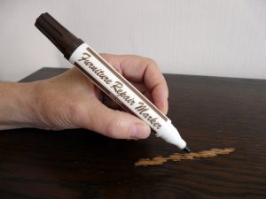 A wood scratch marker to hide surface marks.